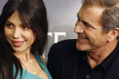 Actor Mel Gibson threatened to hit ex-girlfriend Oksana Grigorieva around the head with a baseball bat in his second recorded rant