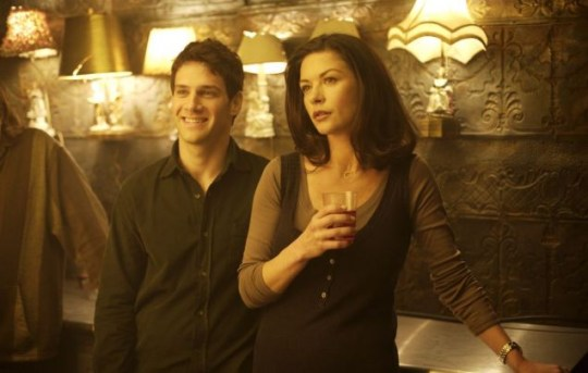 Justin Bartha as Aram and Catherine Zeta-Jones as Sandy in The Rebound