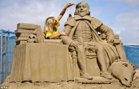 Sand sculptor Nicola Wood puts the finishing touches to William Shakespeare