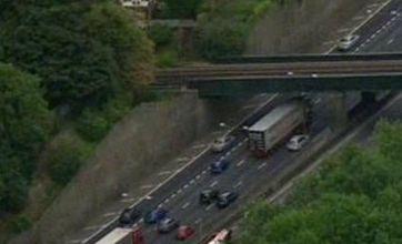 Three hurt as minibus overturns on the M25