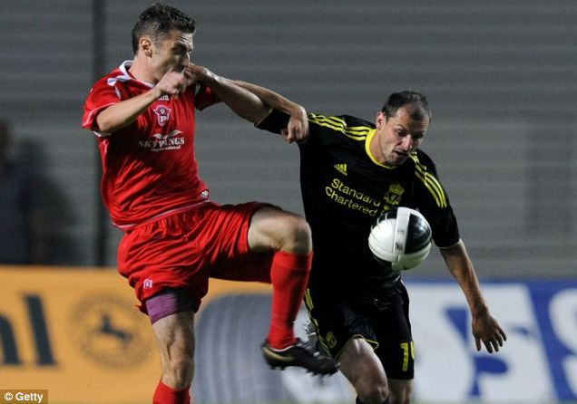 In the black: Liverpool new boy Milan Jovanovic, right, enjoyed a winning start under Roy Hodgson