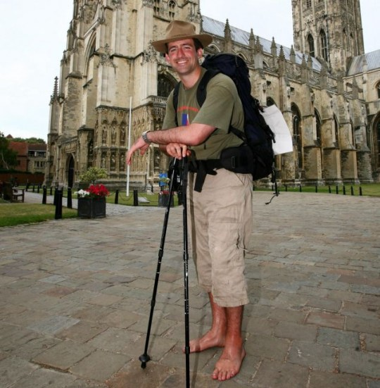 Pole to pole: James Milton leans on his sticks after following the original pilgrim's route to Canterbury cathedral in aid of Help For Heroes (PA)