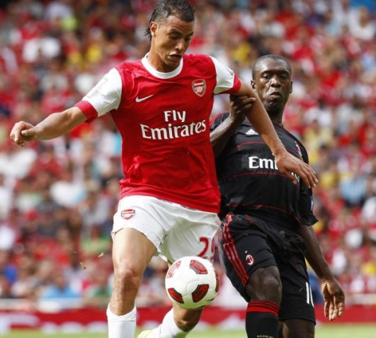 Arsenal's Marouane Chamakh battles with AC Milan's Clarence Seedorf during the Emirates Cup this weekend (PA)