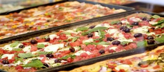 Chart-topper: Pizza has been crowned the UK's favourite dish