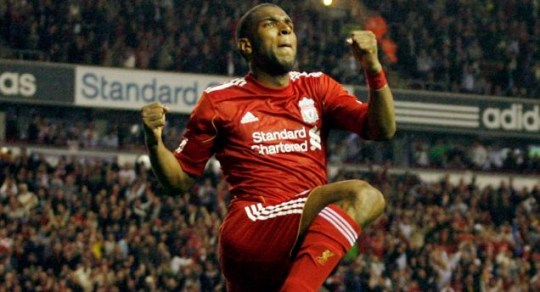Towering Babel: Liverpool's goalscorer celebrates his Anfield opener (Picture: Action Images)