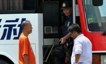 Gunshots heard as sacked policeman holds tourist bus hostage in Manila