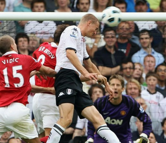 Brede Hangeland scores Fulham's second goal against Manchester United (Photo: Phil Cole/Getty)