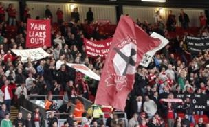 Angry Liverpool fans protested against the club's owners (PA)