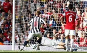 Manuel Almunia saves a West Brom penalty (PA)