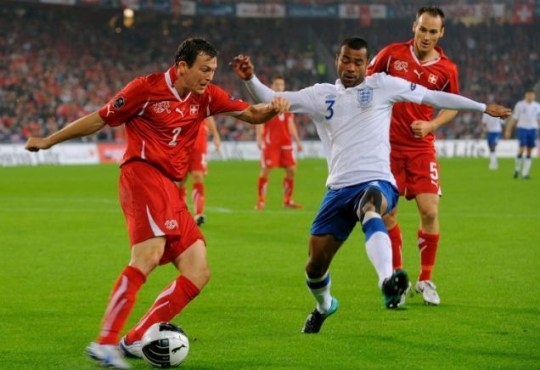 Best in the world: Ashley Cole gets stuck in against Switzerland during England's recent Euro qualifier win (Getty)