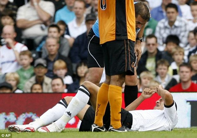 Painful: Bobby Zamora keeps his eyes tight shut to avoid looking down at his fractured ankle