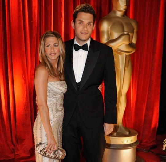 The way they were: John Mayer and Jennifer Aniston at a 2009 Oscar's party (Picture: WireImage)