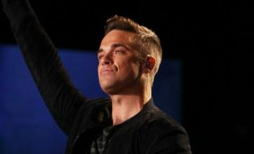 Robbie Williams 'mystery pill' revealed as throat lozenge