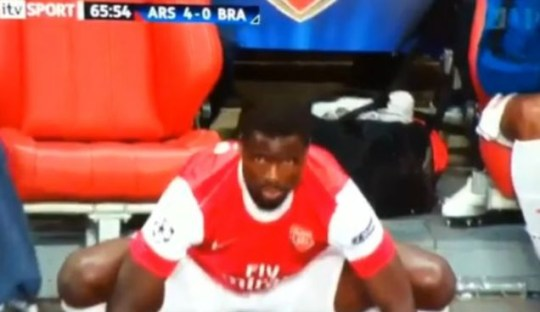 Arsenal's Emmanuel Eboue bounces up and down on the touchline