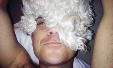 Robbie Williams models dogs on his head as he hits out at fur