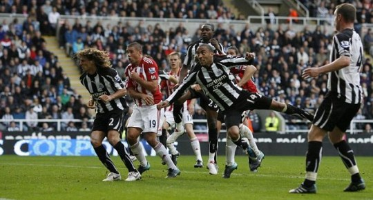 Newcastle's James Perch (14) scores an own goal to give Stoke the lead (Action Images)