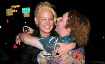 Katherine Heigl gets a smacker from enthusiastic fan