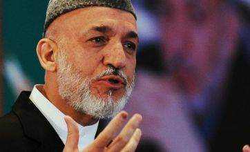 Hamid Karzai in tearful appeal for peace