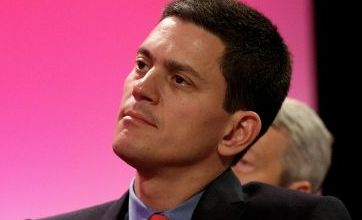 David Miliband leaves early after Iraq war jibe caught on camera