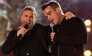 Robbie Williams and Gary Barlow performed Shame (PA)