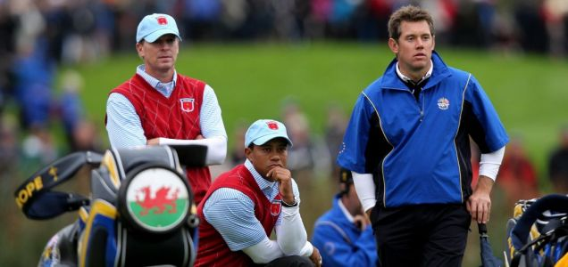 Driven golfers: USA's Tiger Woods (centre) watches play with teammate Steve Stricker and Europe's Lee Westwood (right) (PA)