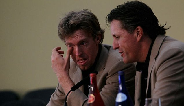 Tearful: An emotional Hunter Mahan is consoled by USA team-mate Phil Mickelson (Getty)