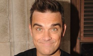 Robbie Williams covers Take That song as Gary Barlow looks on