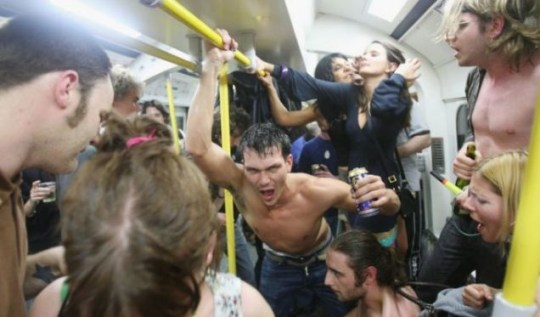 Last night of 'freedom': Revellers celebrate the last night of drinking on the London Underground network, following a Facebook party advert