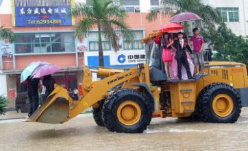 Bride gets to wedding in giant digger