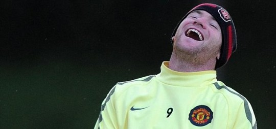 How much are they offering? Manchester United's Wayne Rooney laughs it up during training (Picture: Getty)