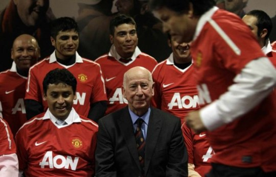 Members of the rescued group of Chilean miners during a visit to Old Trafford. They were invited by Sir Bobby Charlotn (centre) to to enjoy the recent top of the table clash against Arsenal