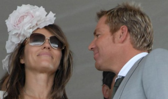 Liz Hurley and Shane Warne together at Goodwood races in July (GoffPhotos)