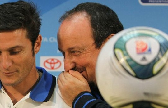 Inter Milan coach Rafael Benitez shares a private joke with Javier Zanetti (AFP/Getty)