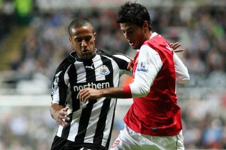 Liverpool transfer target Wayne Routledge, left, vies for the ball with Arsenal's Carlos Vela (AP)