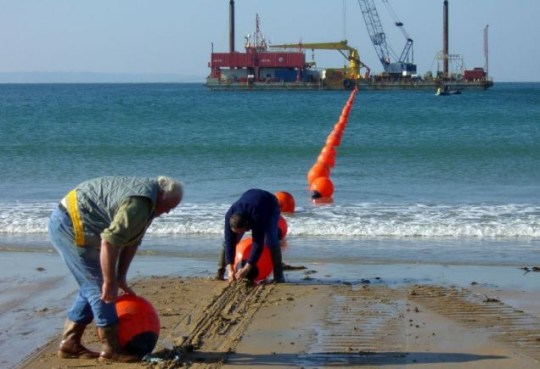 Workers carrying out repairs to one of the hundreds of submarine cables that carry internet and phone traffic
