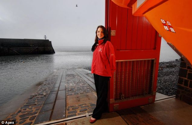 Keeping up tradition: Lauren McGuire takes charge at the Clovelly lifeboat station Pictures: Apex