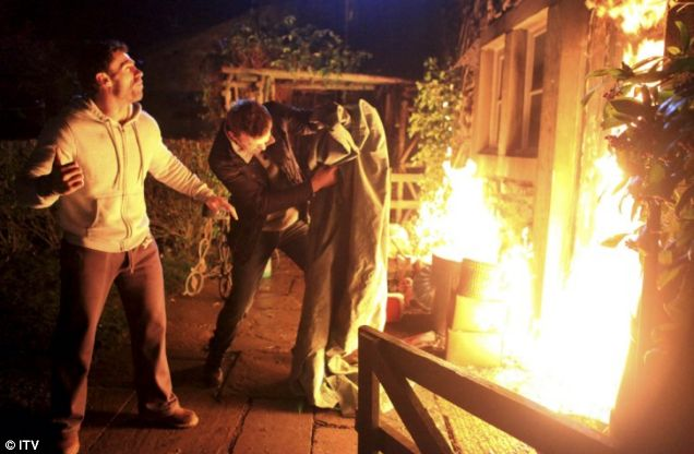 Andy Sugden and Carl King shout for Katie as the fire quickly spreads
