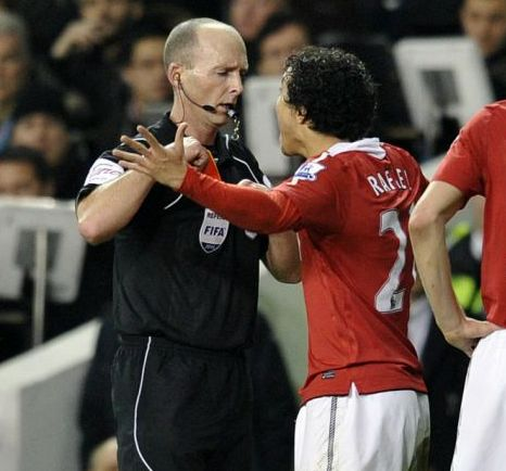 Game over: Manchester United's Brazilian defender Rafael Da Silva receives a red card from referee Mike Dean (AFP/Getty Images)