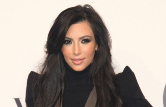 Kim Kardashian could be starring alongside John Travolta in Gotti (Getty)