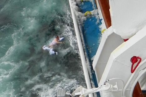 Overboard: Rescuers try to pass Mrs Richardson to a lifeboat beofre she falls into the sea (Picture: Patrick Hill)