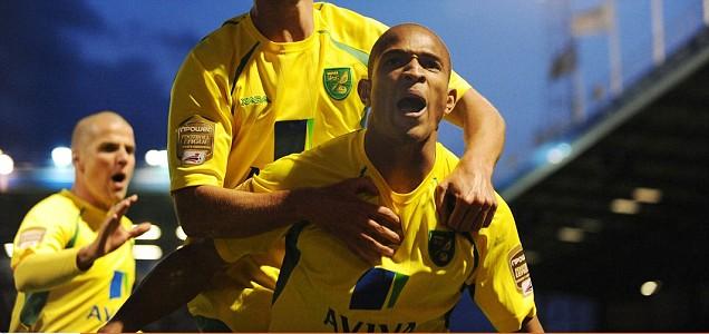 Simeon Jackson nods the goal that finally sends Norwich back to the Premier League