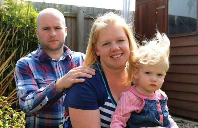Happy family: Matt and Donna Hewetson with daughter Lily, who triggered a lifethreatening illness in her mother when she was carrying her. Mrs Hewetson refused to end the pregnancy Picture: Caters
