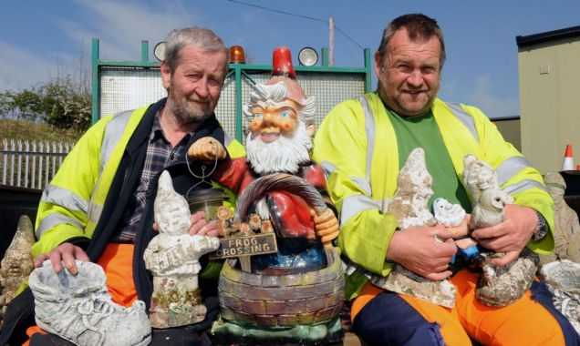 Elf risk: Council workers with Veronica Pratt's gnomes after removing them from her funeral route (Picture: WNS)