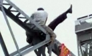 Video emerges of angry passer-by pushing suicidal man off China bridge