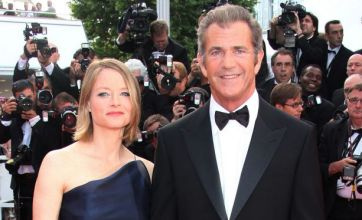 Mel Gibson puts on a brave face at Cannes premiere as The Beaver slated