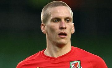 QPR release eight players 'in a bid to raise funds for Steve Morison bid'