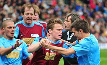 Alastair Campbell clashes with The Wanted's Tom Parker during charity match