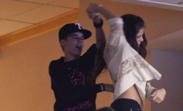 Justin Bieber and Selena Gomez dancing for joy at basketball game