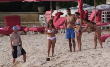Kai Rooney 'buried alive' as Wayne and Coleen enjoy family beach break