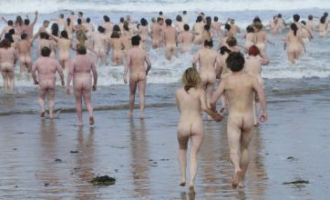 Skinny dippers brave cold to set new nude world record